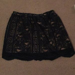 Lace-like forest green skirt